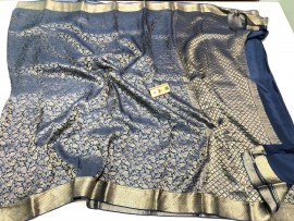 Pure crepe silk sarees with nesting silver zari weaves