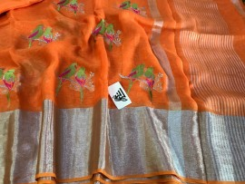 Orange linen with green enbroidered sarees
