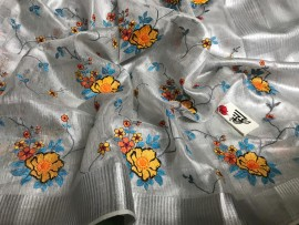 Silver linen tissue sarees with orange and blue embroidery work