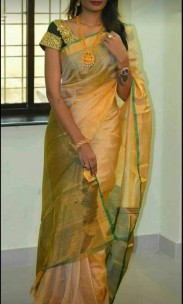 Cream and dark green uppada tissue sarees