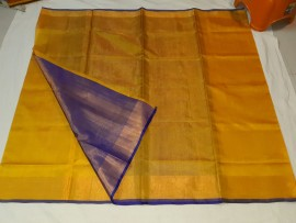 Golden yellow with blue uppada plain tissue sarees