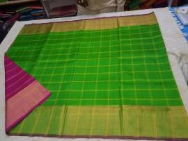 Apple green with dark Magenta Uppada checks with jari border