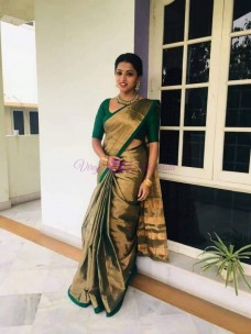 Dark green uppada tissue cotton sarees