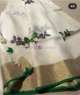 White with dark green linen embroidered sarees