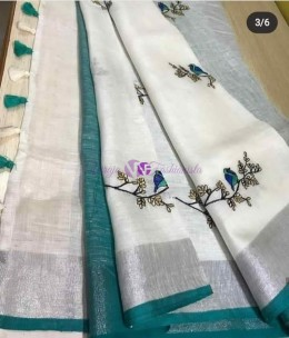 White with peacock blue linen embroidered sarees