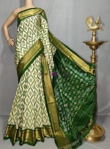 Cream and dark green handloom ikkat silk sarees