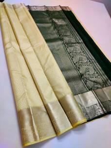 Creamy yellow and dark green pure kanchipuram silk sarees