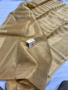 Gold tussar tissue silk sarees with grand border