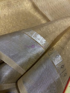 Gold tussar tissue silk sarees with silver border