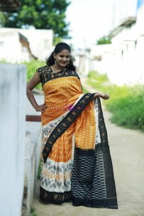 Light orange with black handloom ikkat cotton sarees