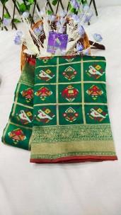 Dark green pure banarasi patola silk sarees